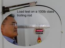 This image shows a trolling rod be ing tested. Osprey spinning rods will also ungo the same curve test load when the blank is formed.